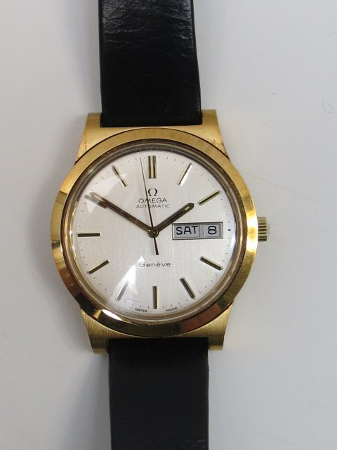 A gents Omega automatic Geneve strap watch. Gold plated