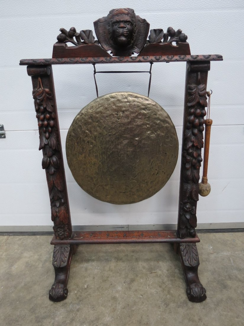 A good free standing oak framed gong stand, lion's mask