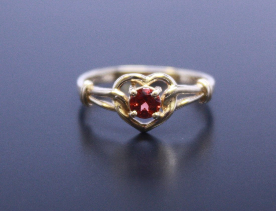 14k Yellow Gold Heart Ring With A Red Center Stone