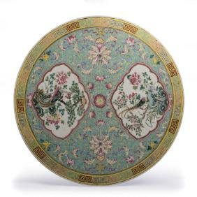 Famille rose circular plaque in Chinese porcelain