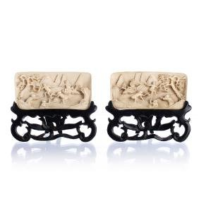 Pair of Chinese ivory wrist rests with figures