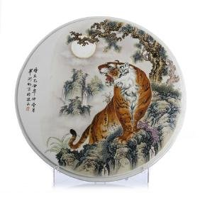 "Circular ""tiger"" plaque in Chinese porcelain"