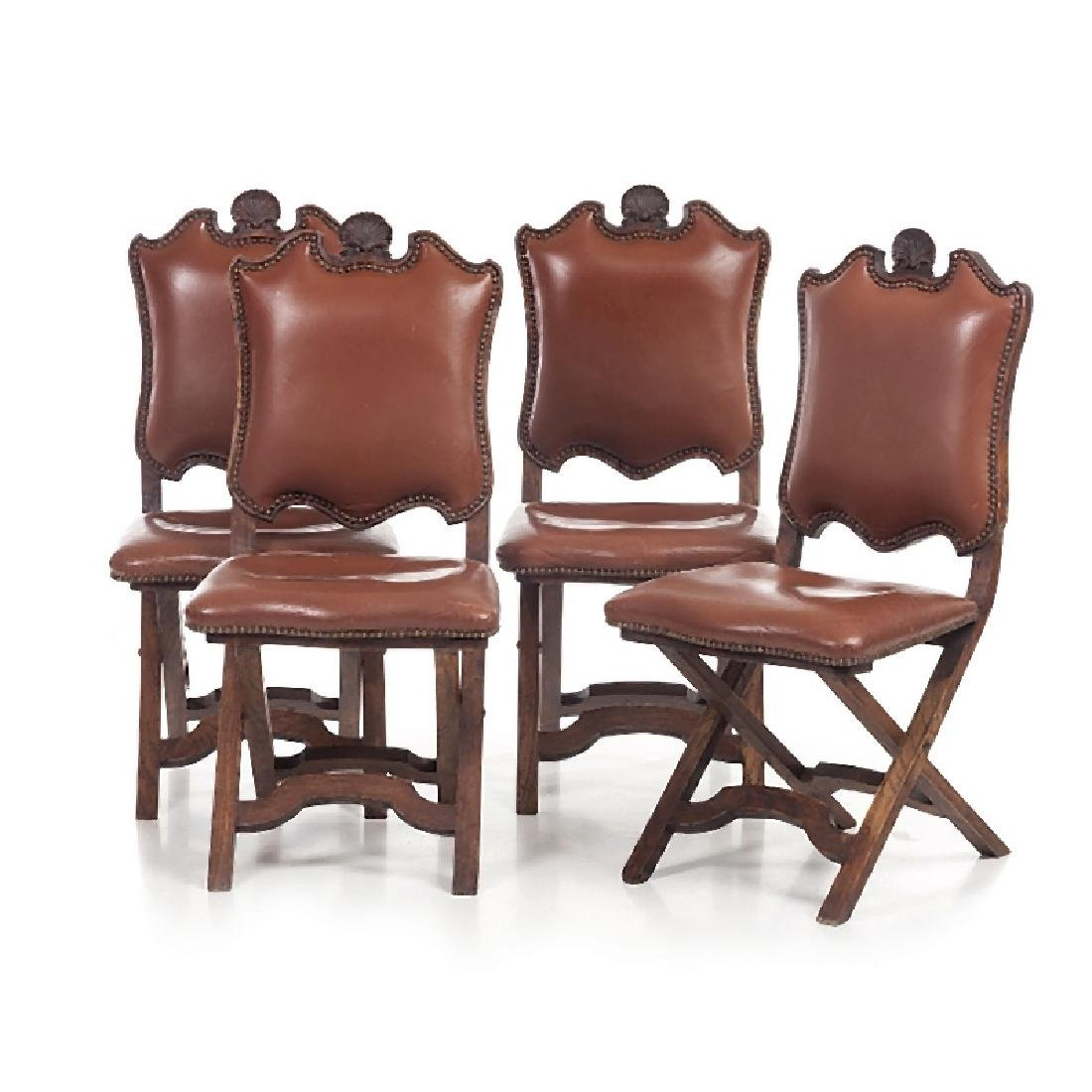 Eight scissor chairs in leather