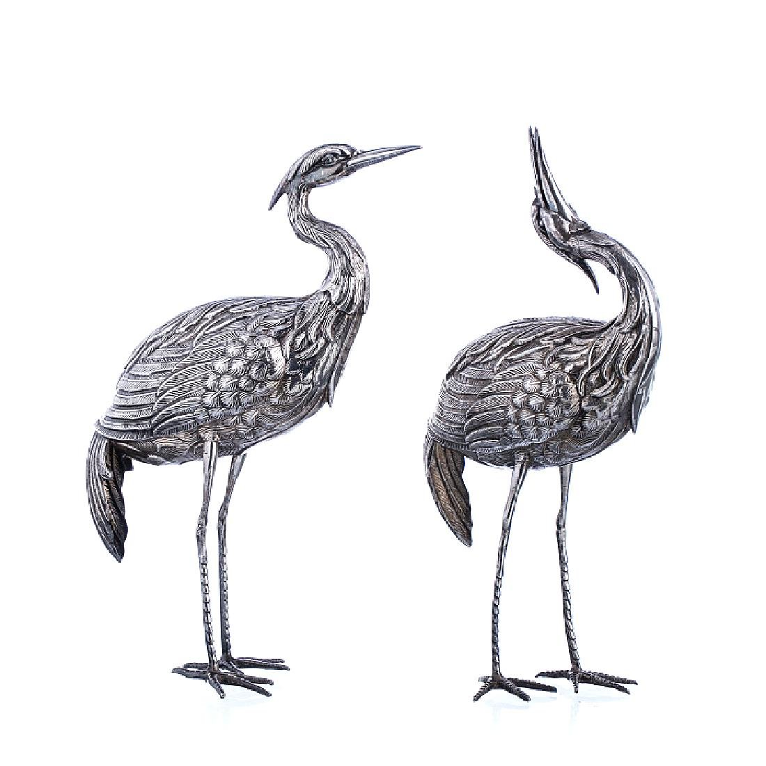 Two cranes in Spanish silver