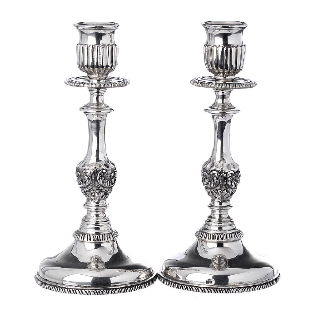 Pair of candlesticks in relieved silver