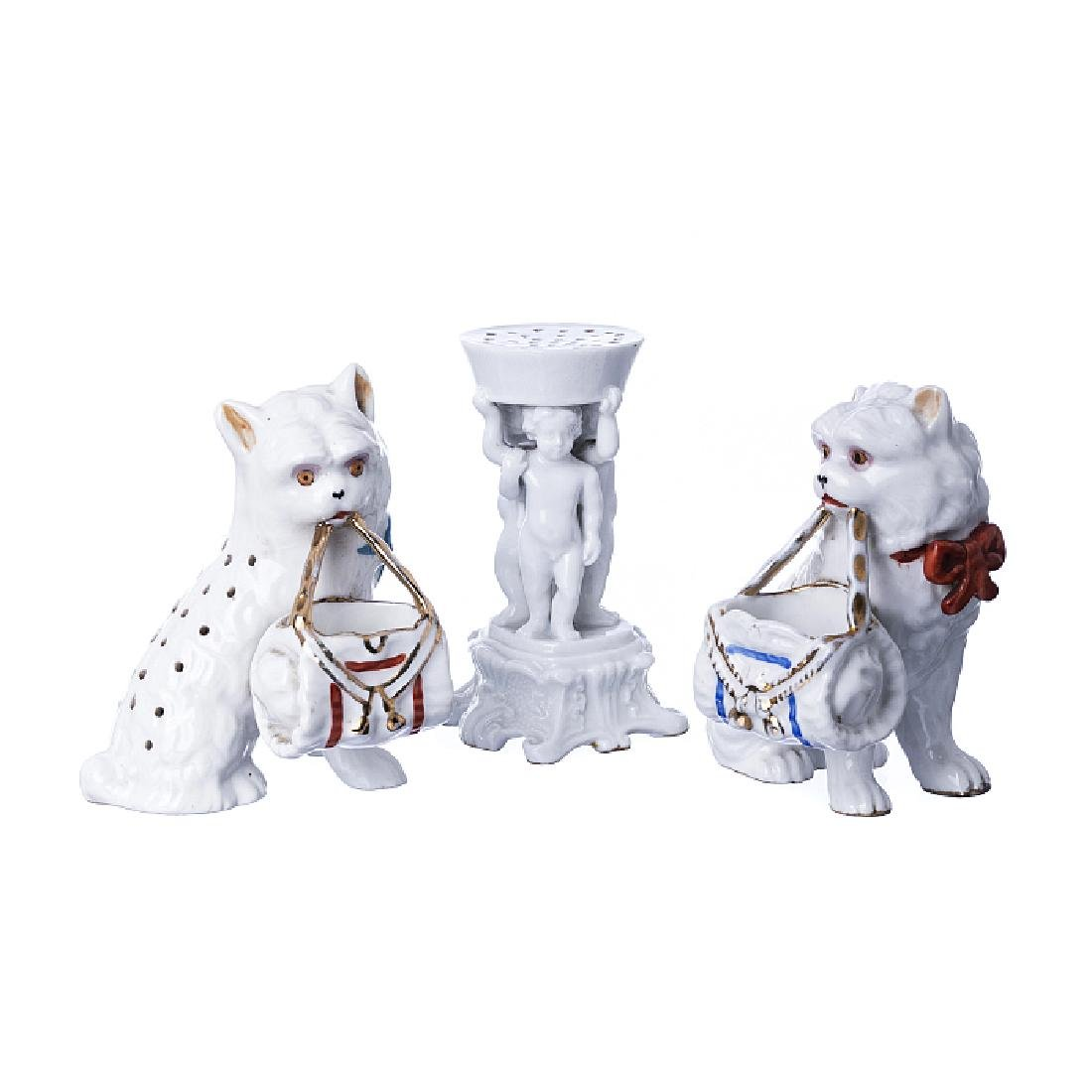 Three toothpick holders in porcelain