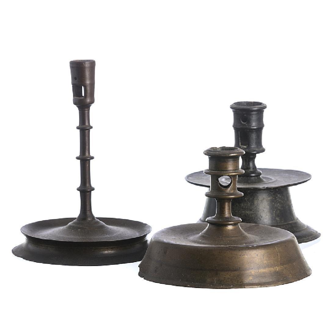 Three trumpet-shaped candlesticks