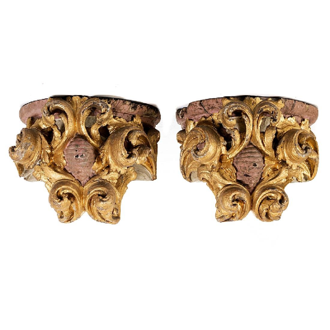 Pair of wall brackets with plant motifs