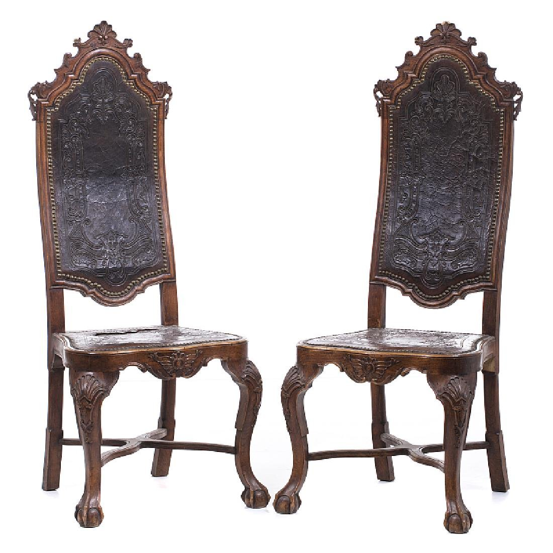 Pair of hide chairs with pierced mounts