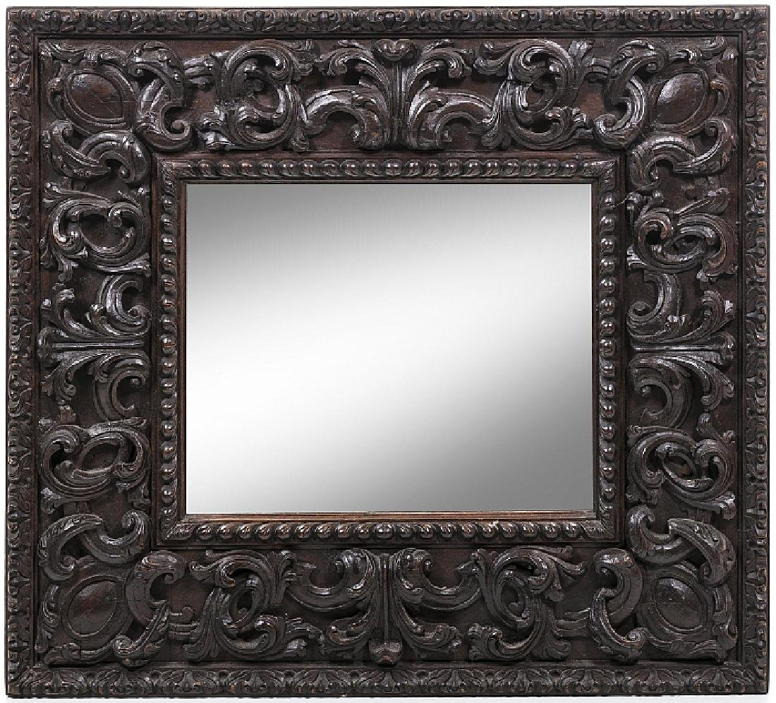 Mirror in carved wood