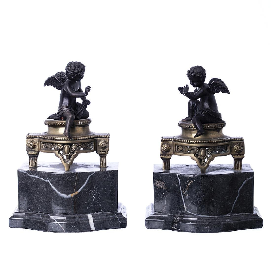 Pair of bookends in marble and bronze, angels