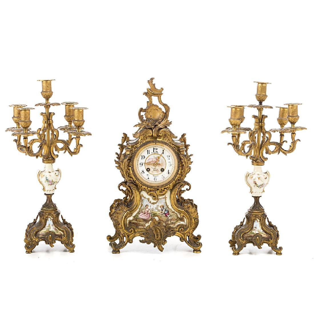 Three pieces of a table clock in bronze and porcelain