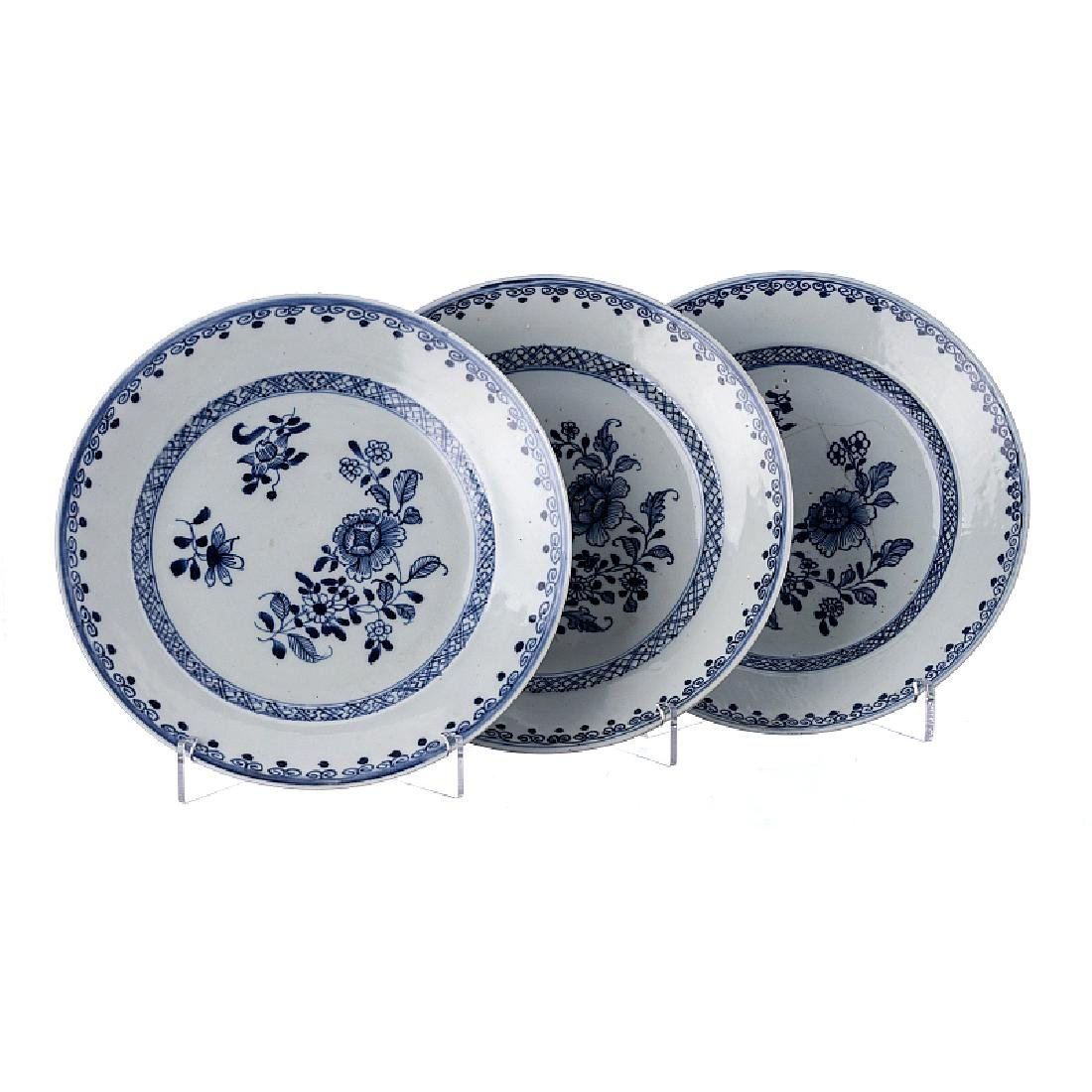 Three plates with 'flowers' in porcelain from China