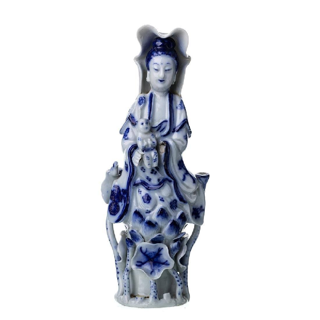 Guanyin with a boy in Chinese porcelain