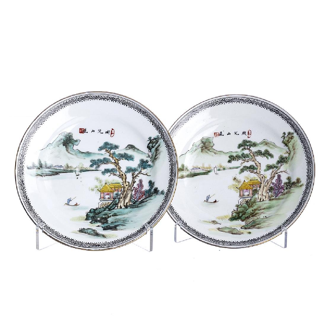 Pair of small 'landscape' dishes in Chinese porcelain