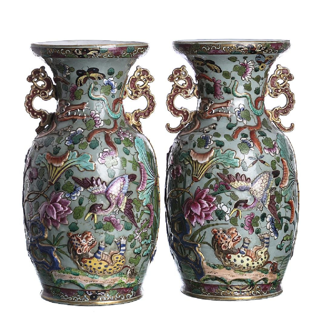 Pair of celadon porcelain relif decorated vases