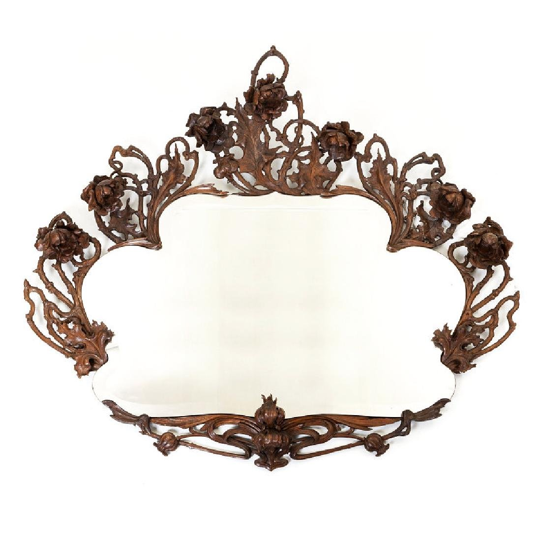 Large art nouveau mirror in carved wood