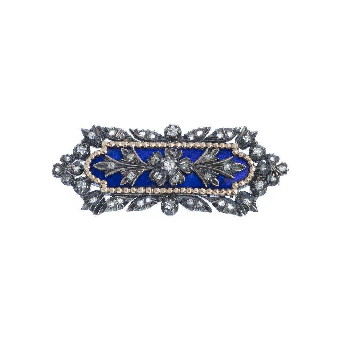 Gold and silver brooch with diamonds and enamels