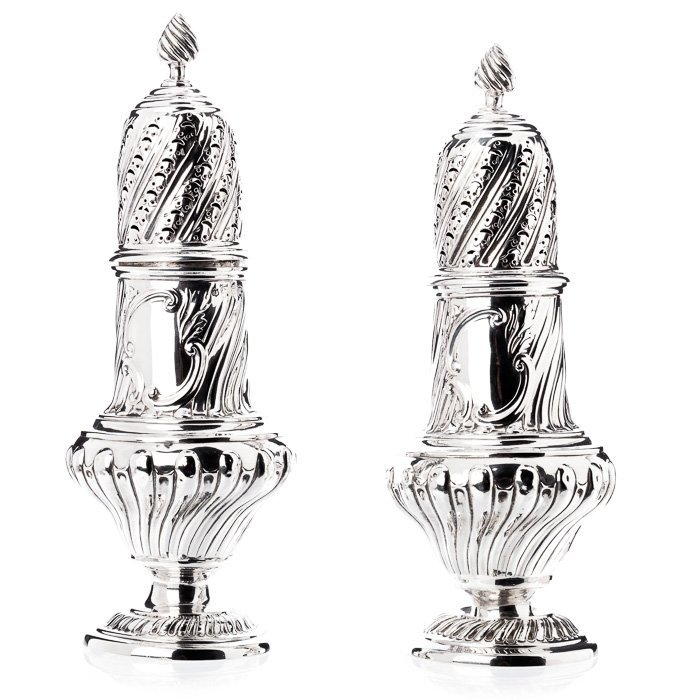 Pair of cinnamon casters in English silver