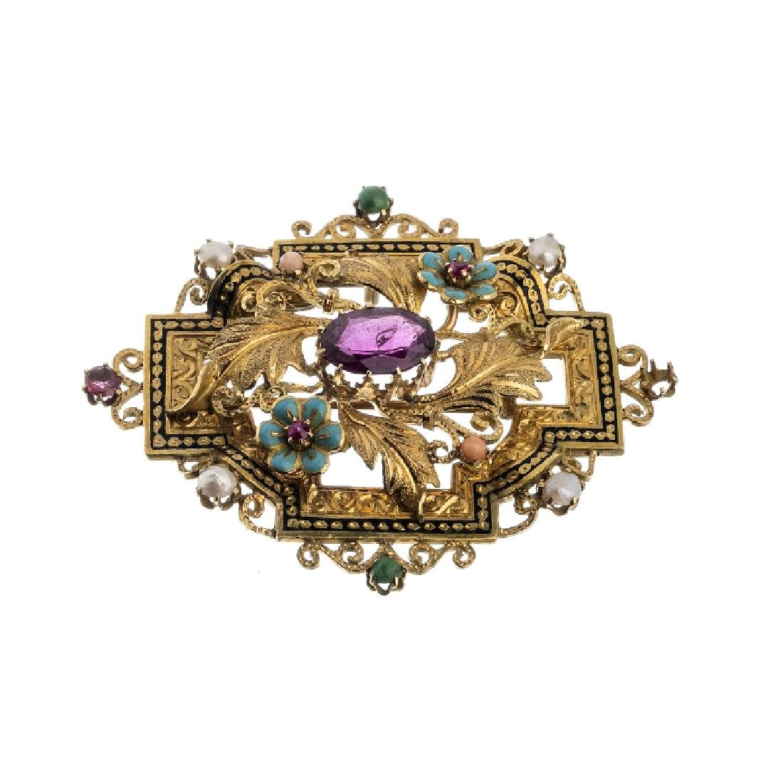 Gold pin with fine stones