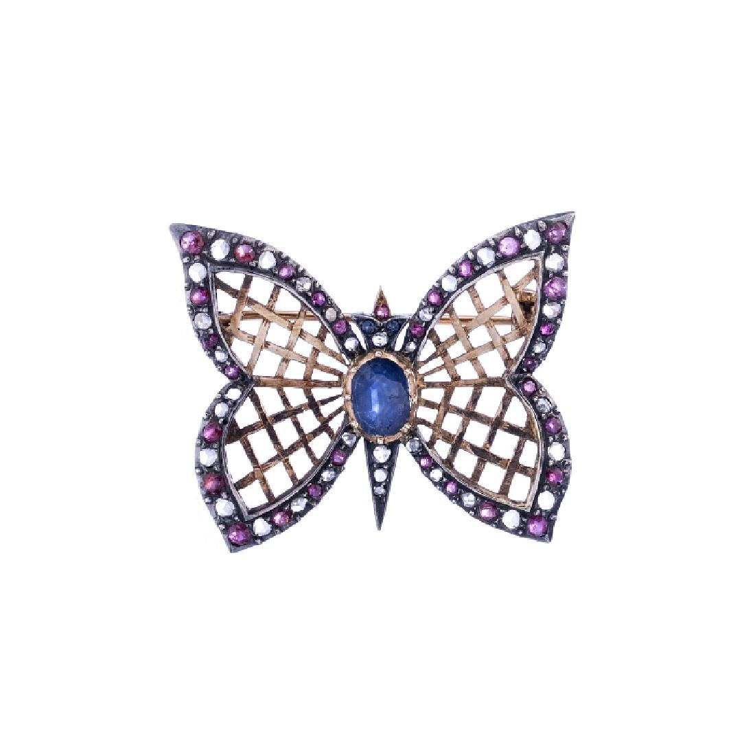 Pin with a 'butterfly' in silver and gold, with