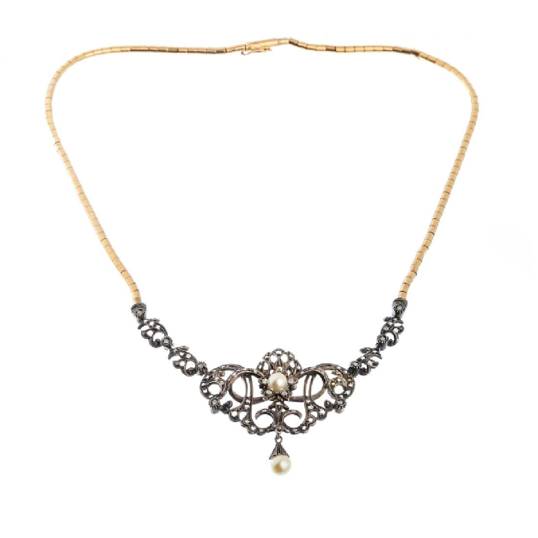 Gold necklace, silver center with diamonds