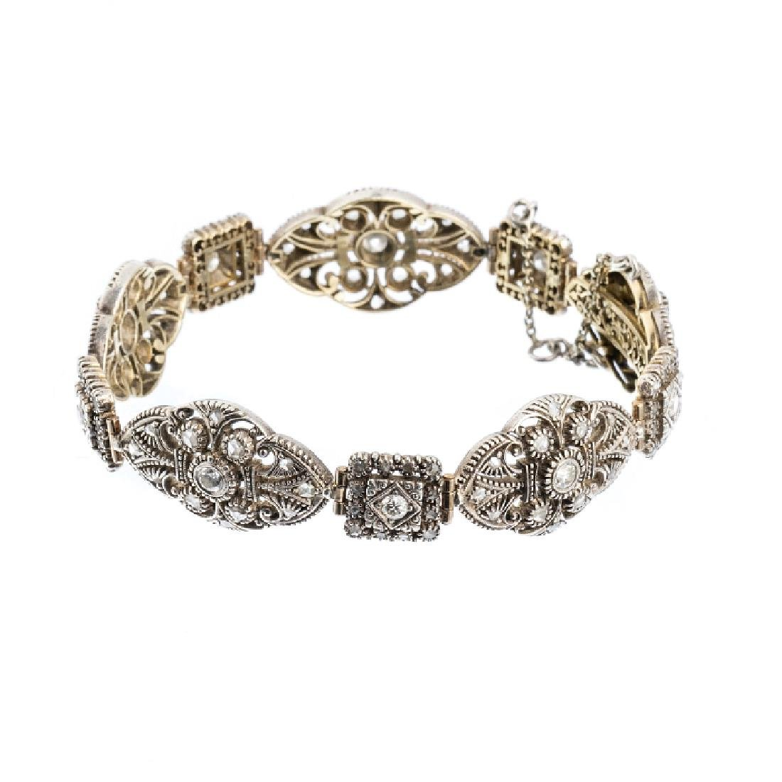 Gold, silver bracelet with diamonds