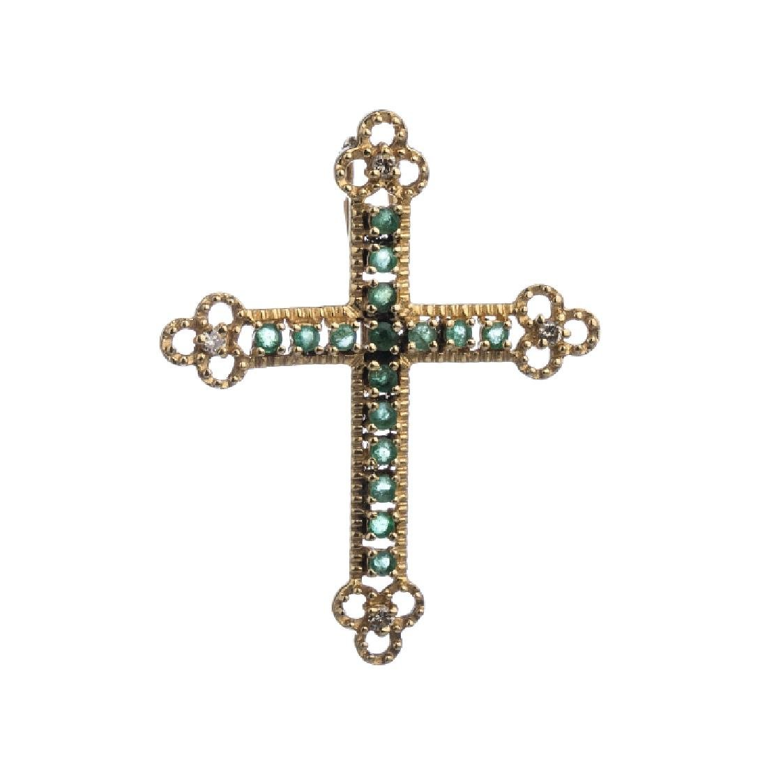 Gold cross with diamonds and emeralds