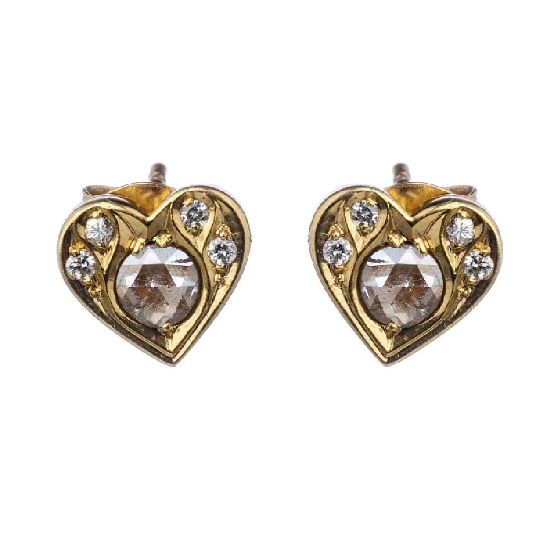 "Pair of ""heart"" earrings, with diamonds"