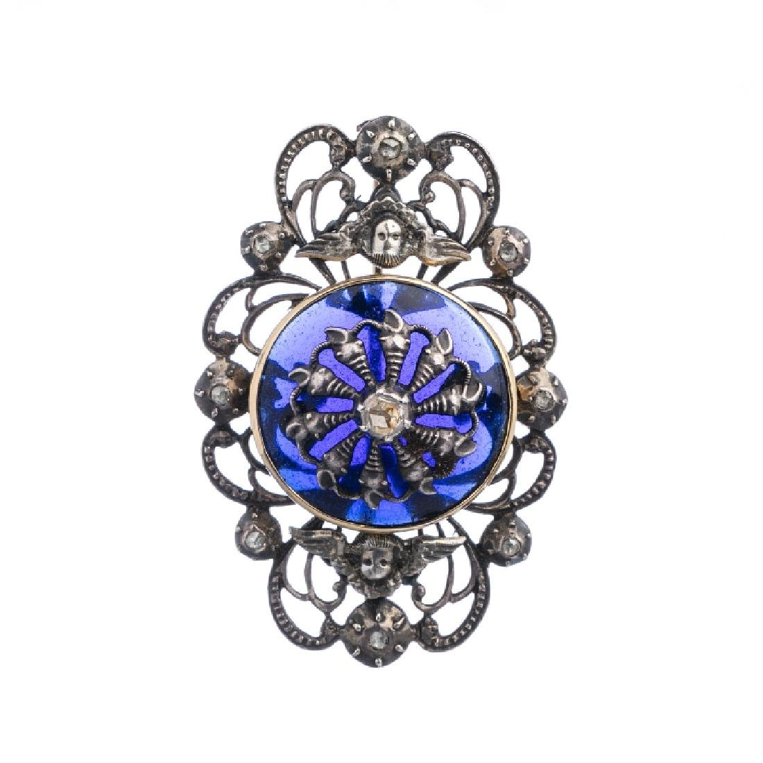 Silver, gold brooch with glass and diamonds