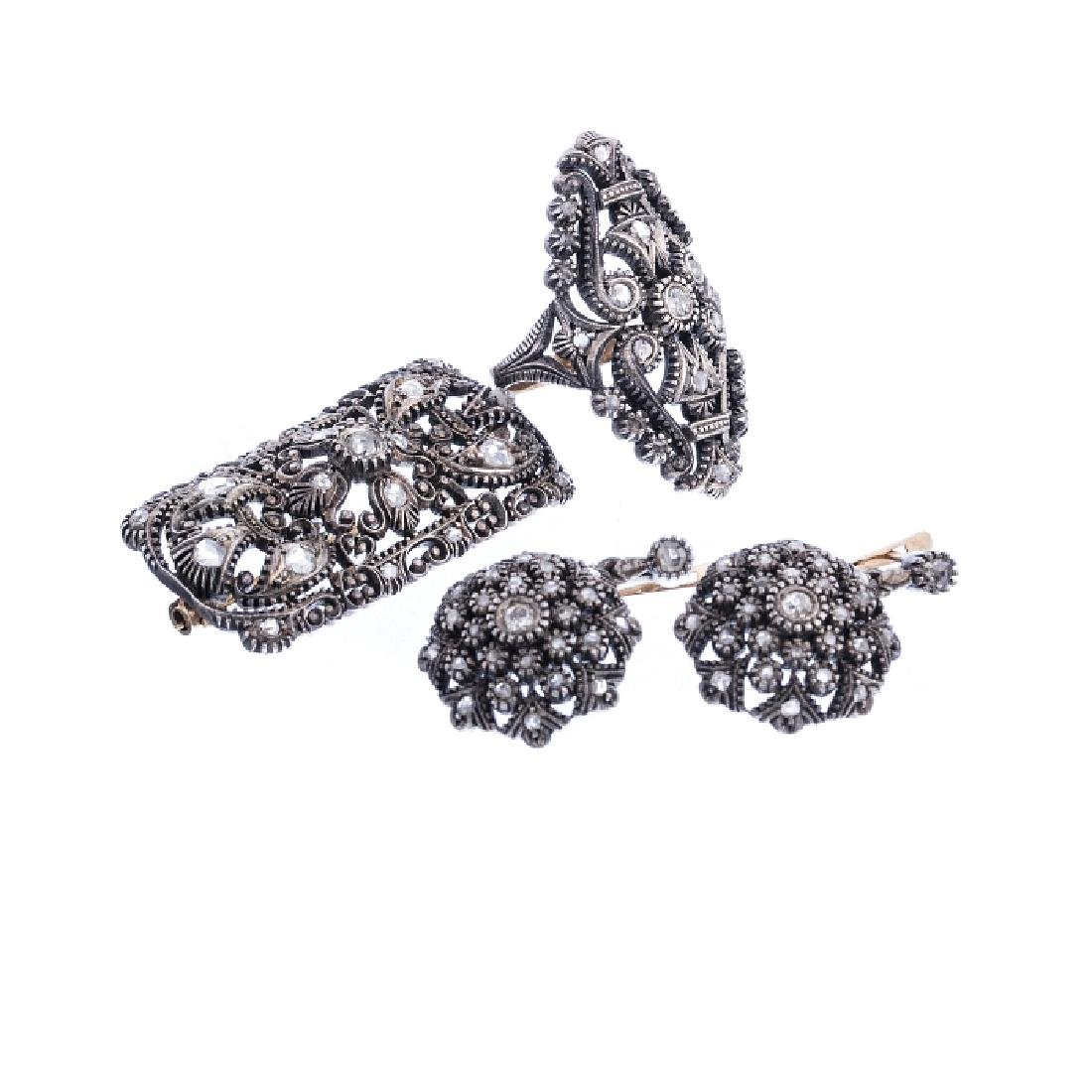 Pair of earrings, broach and ring in silver with
