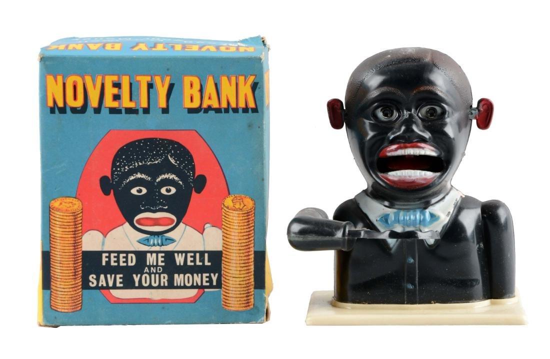Plastic Jolly Mechanical Bank.