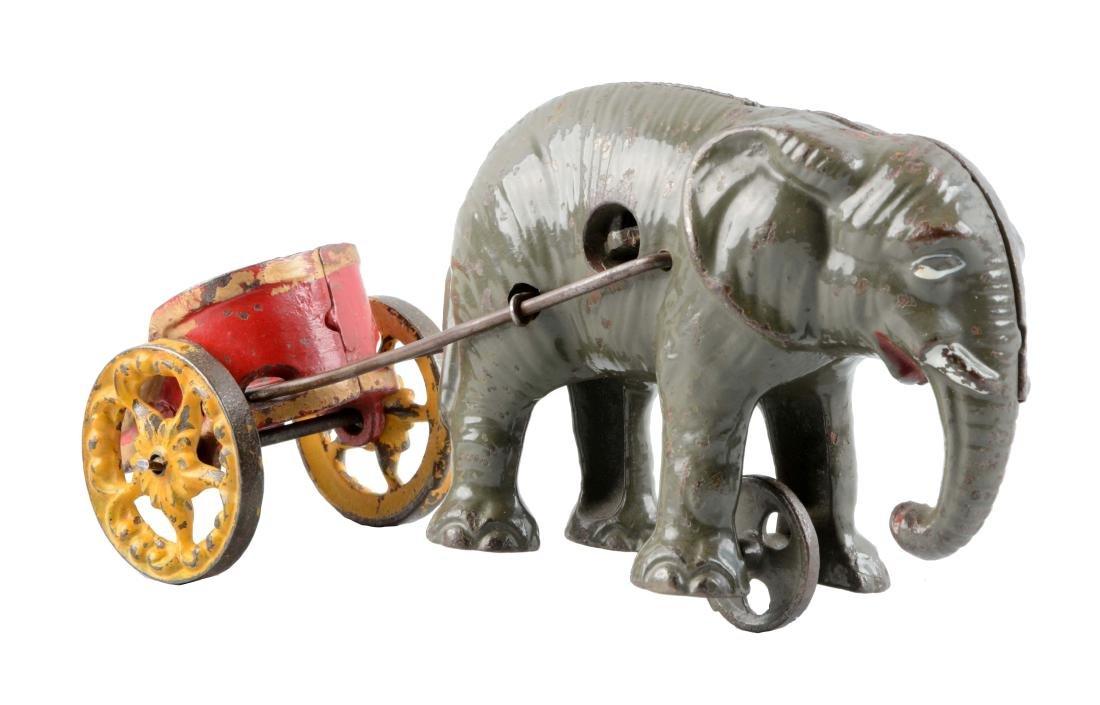 Cast Iron Elephant Pulling Cart Bank.