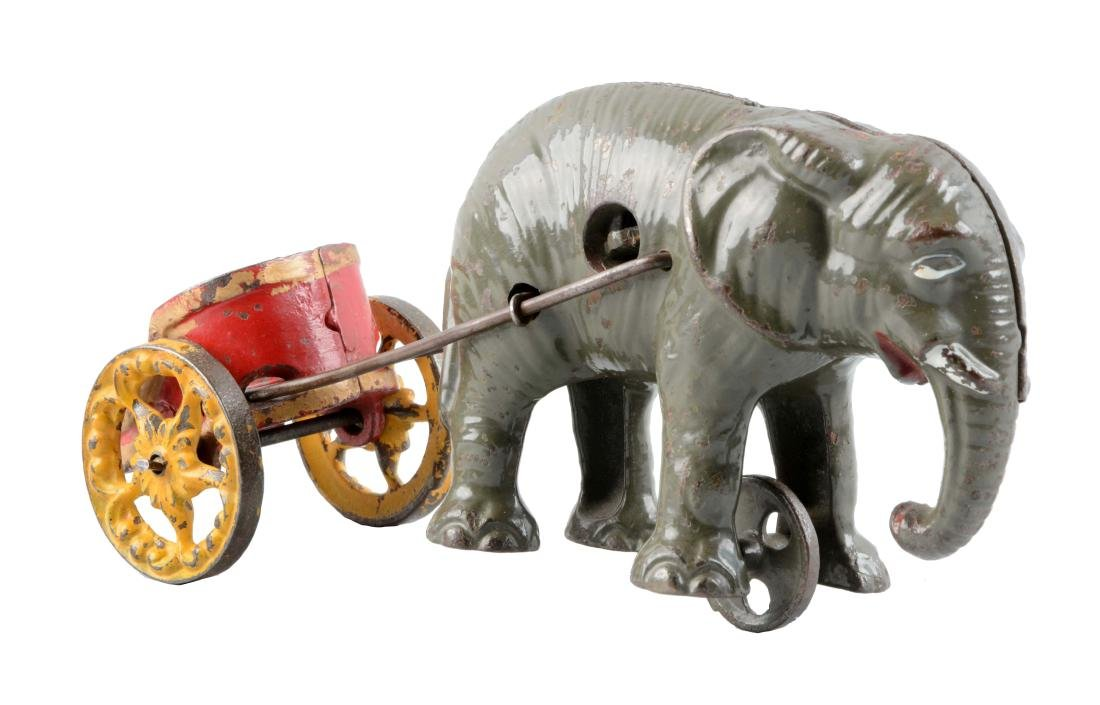 Cast Iron Elephant Pulling Cart Bank.