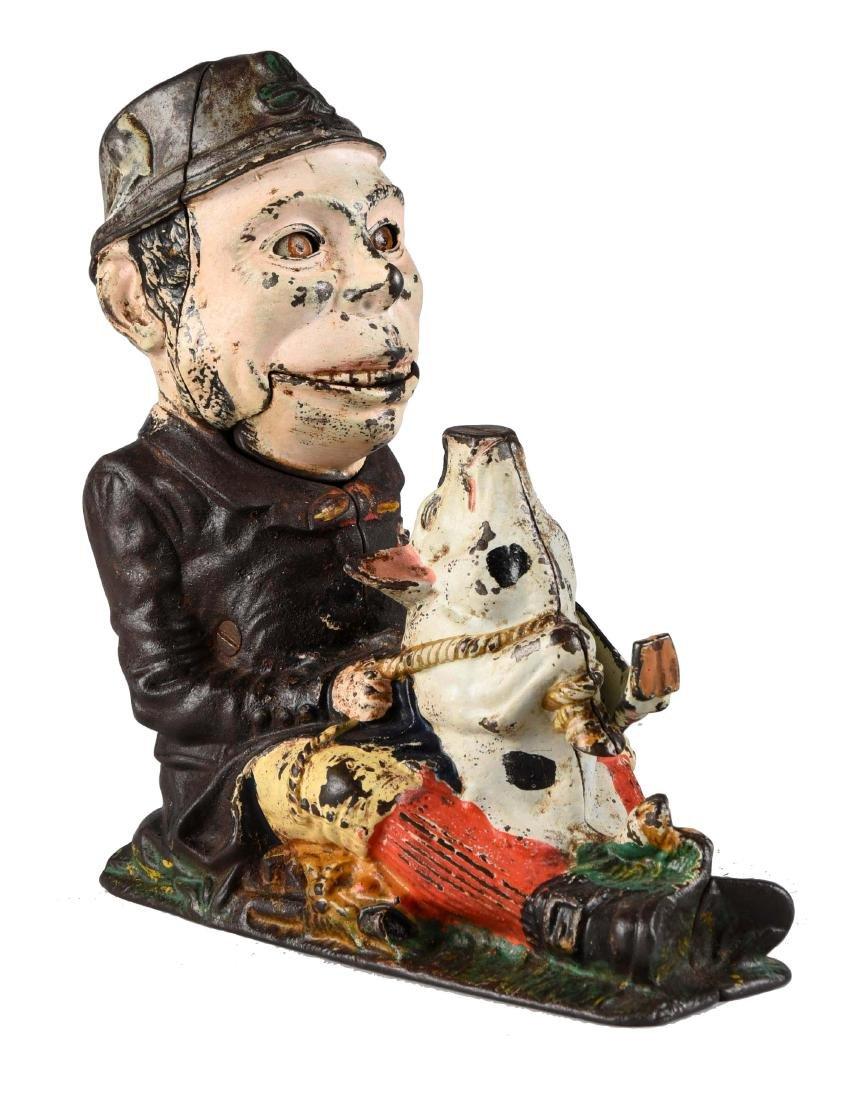 J. & E. Stevens Cast Iron Paddy & Pig Mechanical Bank.