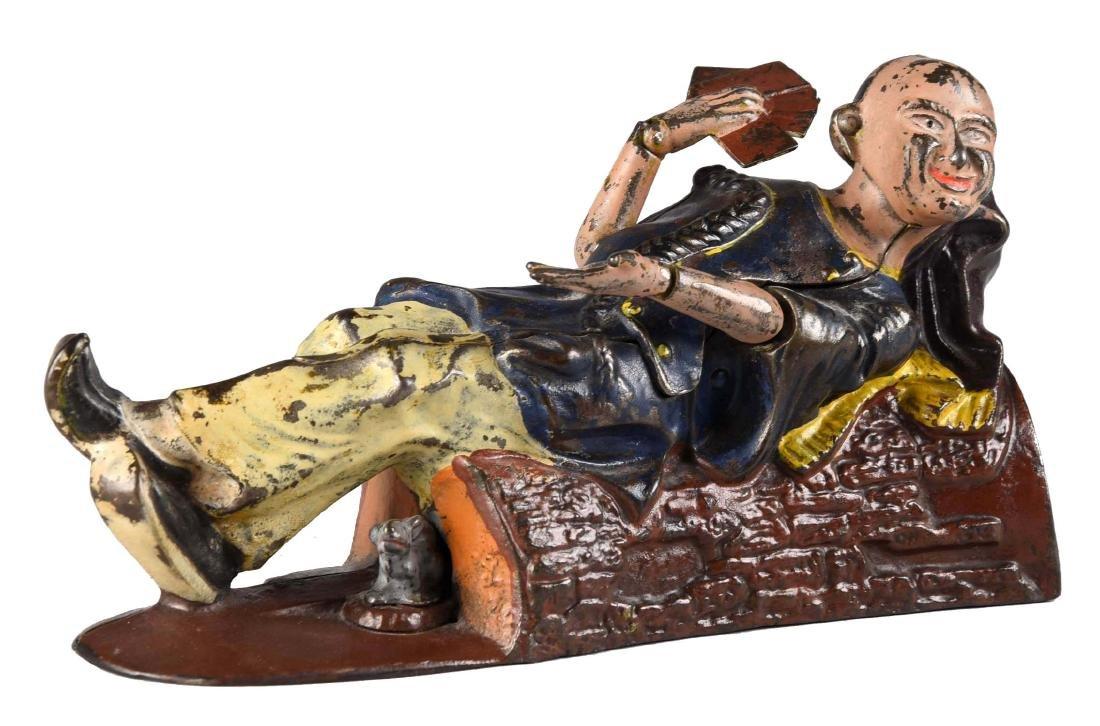 J. & E. Stevens Cast Iron Reclining Chinaman Mechanical