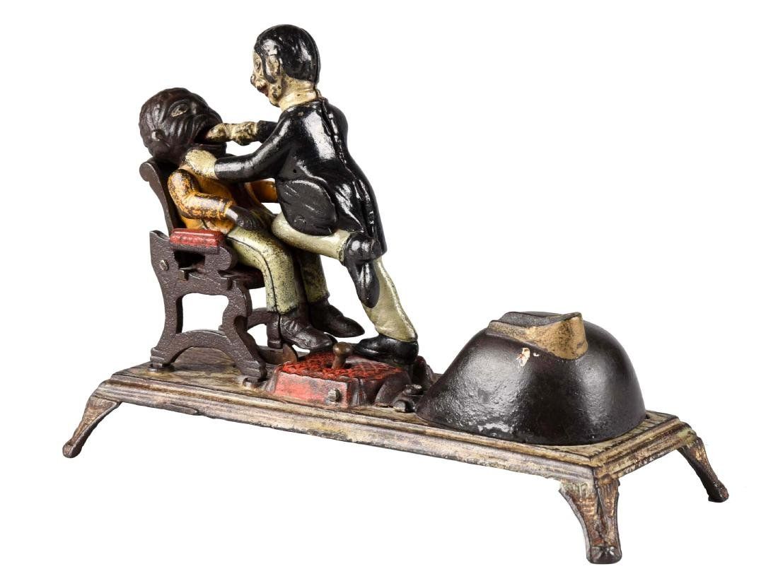 J. & E. Stevens Cast Iron Dentist Mechanical Bank.