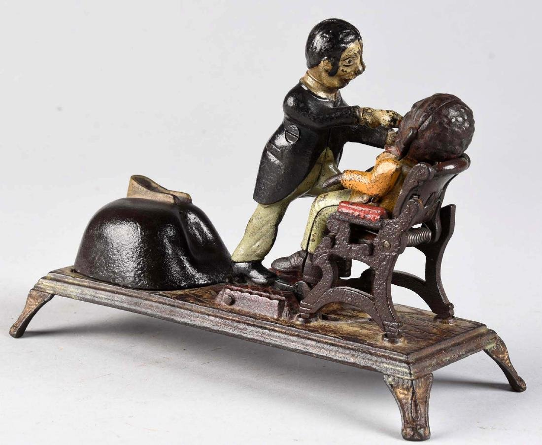 J. & E. Stevens Cast Iron Dentist Mechanical Bank. - 2