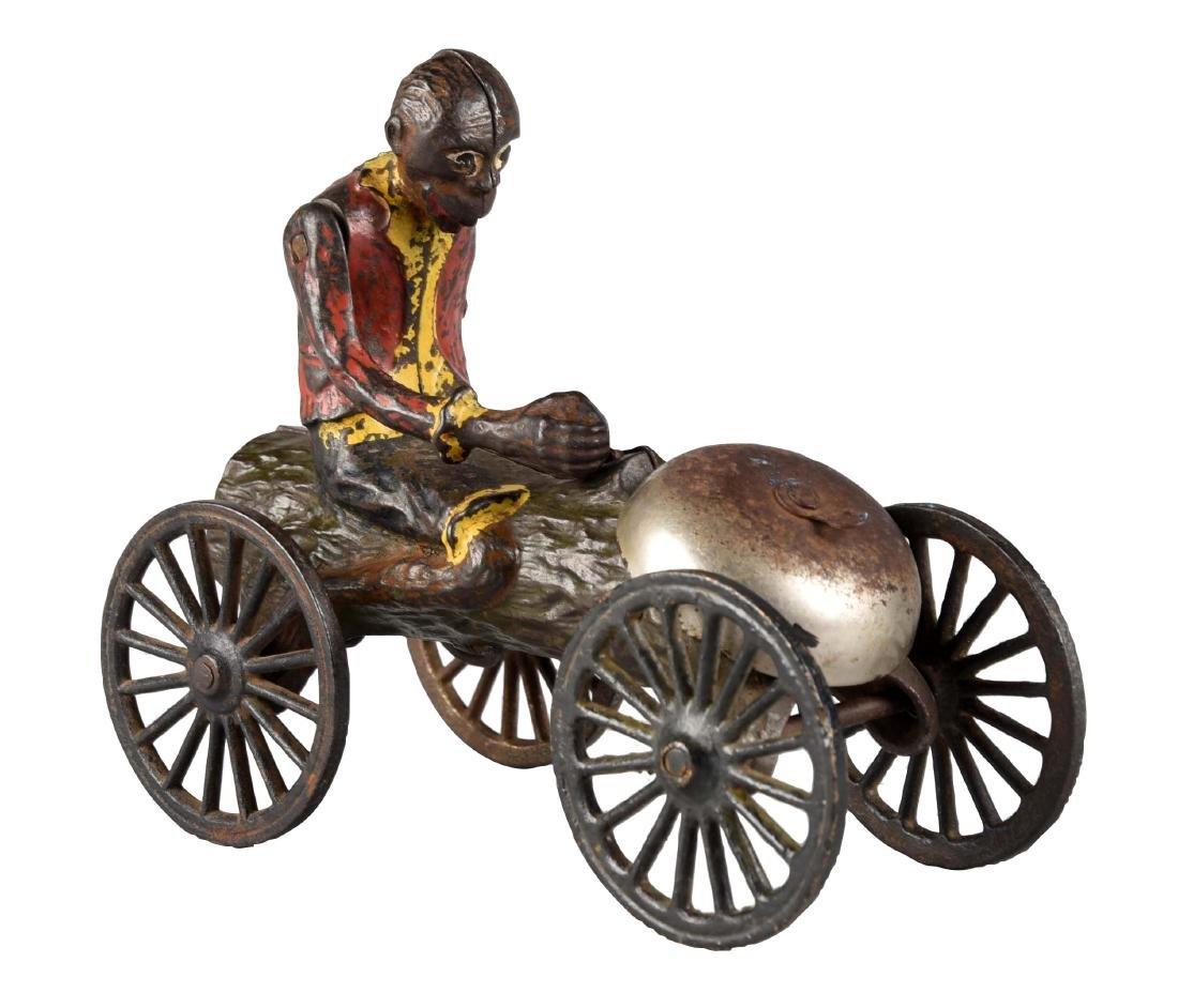 Cast Iron Monkey on Log Bell Toy.