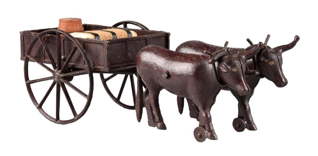 Rare Ives Two Oxen Drawn Cast Iron Cart.