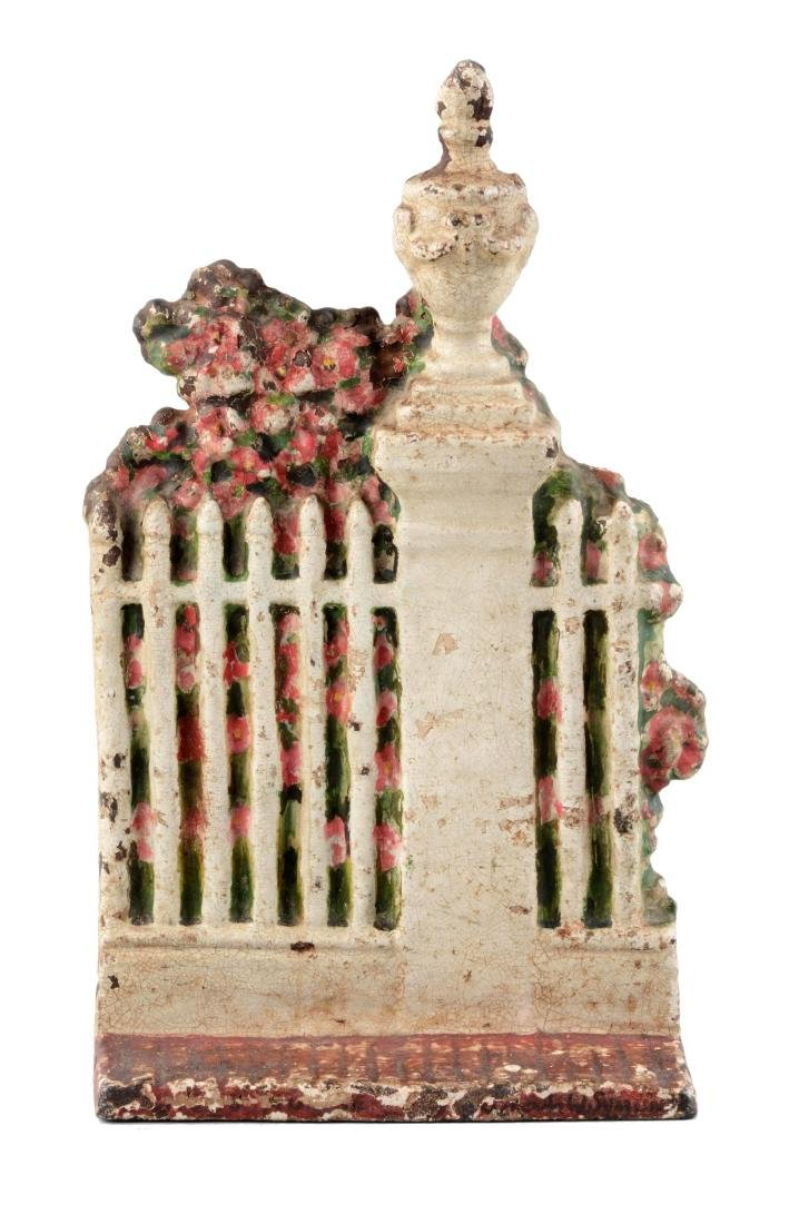 Cast Iron Fence w/ Urn & Shrubs Doorstop.