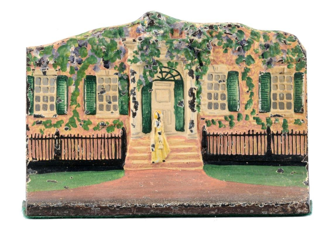 Cast Iron Cottage With Woman On Steps Doorstop.