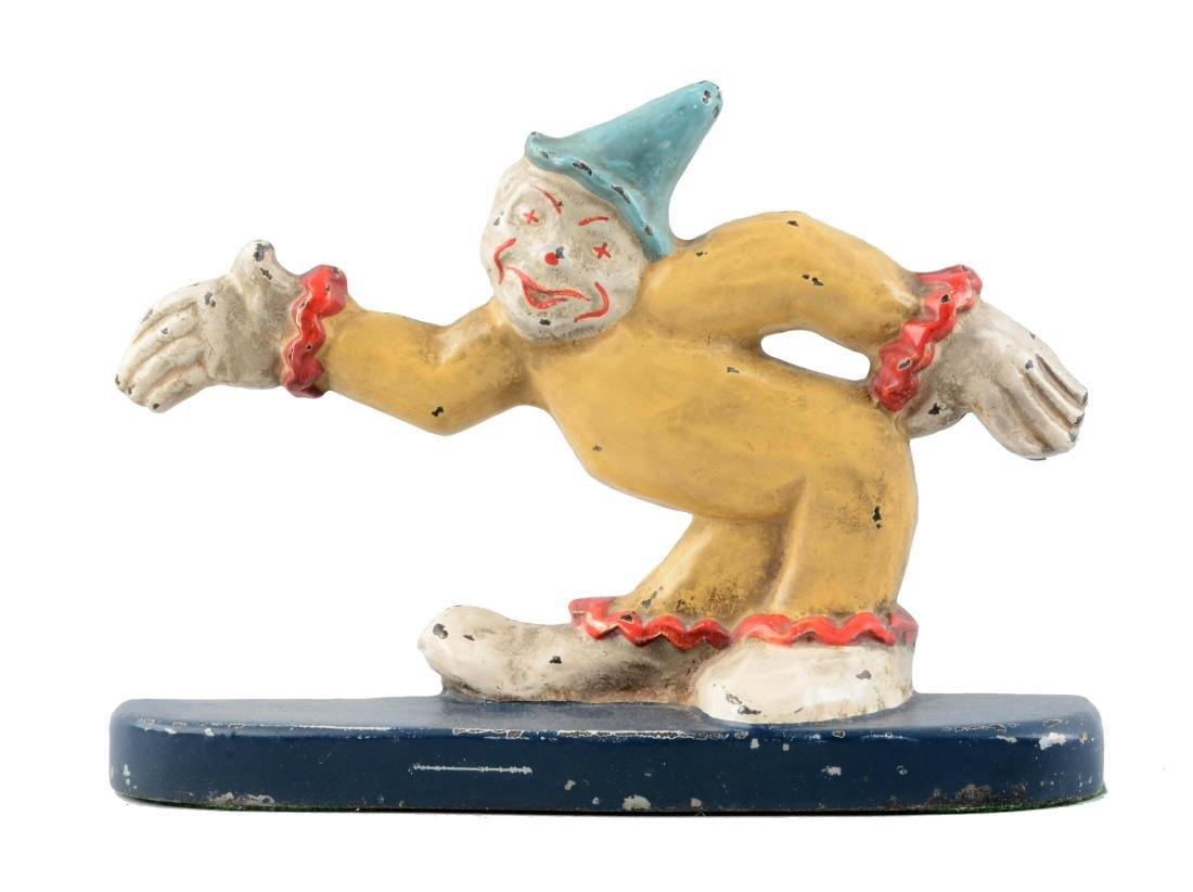 Cast Iron Clown With Arm Stretched Out Doorstop.
