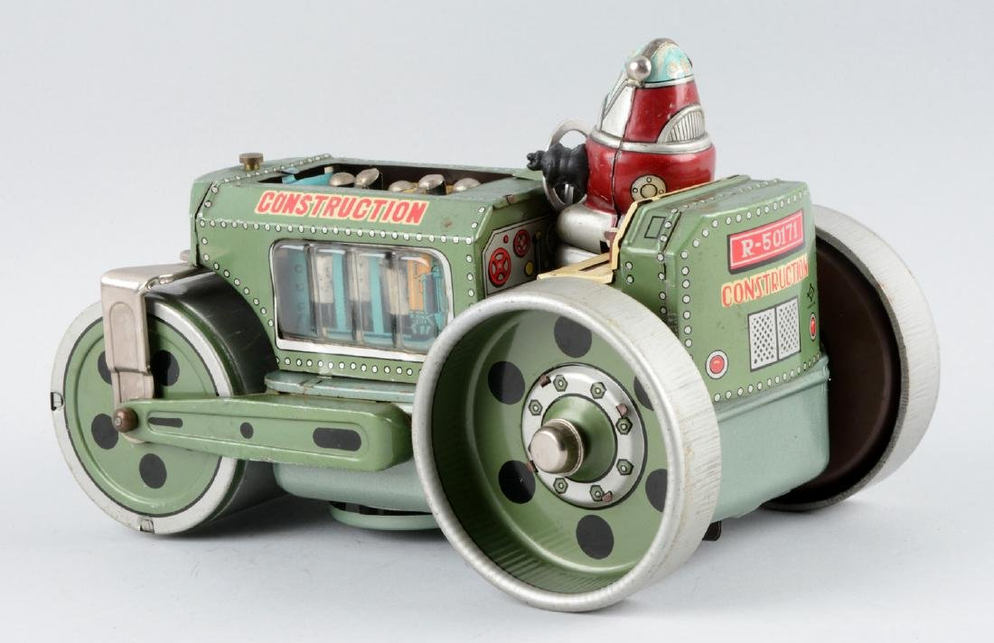 Japanese Tin Litho Battery-Operated Robby Roller. - 2