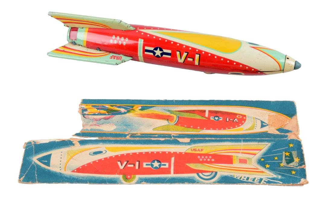 Japanese Tin Litho Friction V-1 Sparkling Rocket.