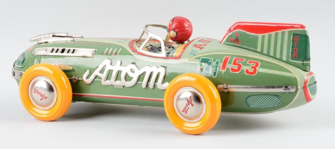 Japanese Tin Litho Friction Atom Race Car. - 2