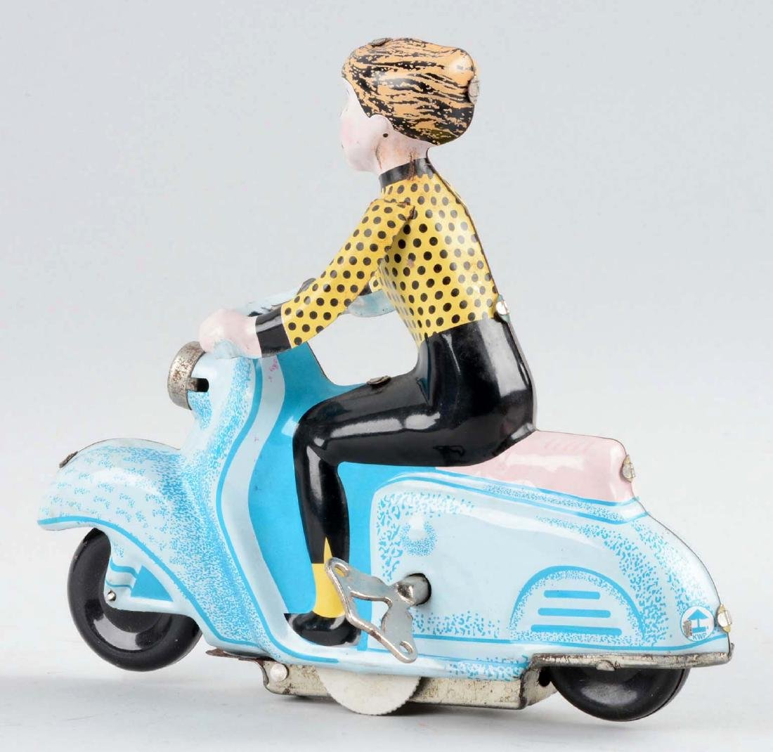 Tin Litho Wind-Up Woman Riding Scooter Toy. - 2