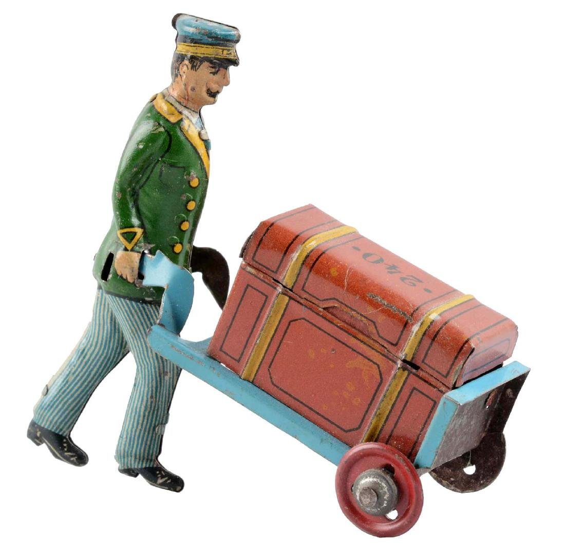 German Tin Litho Porter Pushing a Trunk Penny Toy.