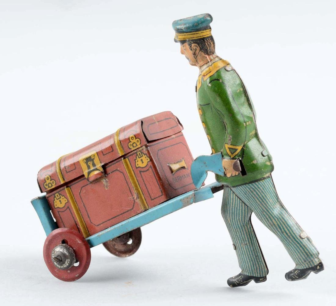 German Tin Litho Porter Pushing a Trunk Penny Toy. - 2
