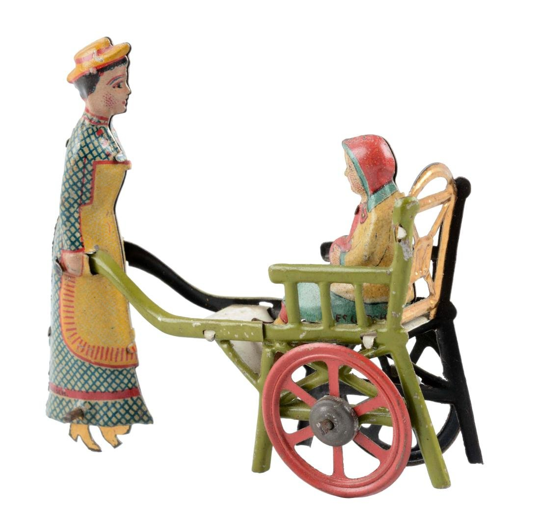 German Tin Litho Nanny Pushing a Child Penny Toy.